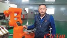 """【中国梦·践行者】甩掉""""低端""""标签让世界认可 他把机器人""""一抓一放""""做到极致"""